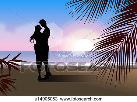 Silhouette of a couple embracing each other on the beach ...