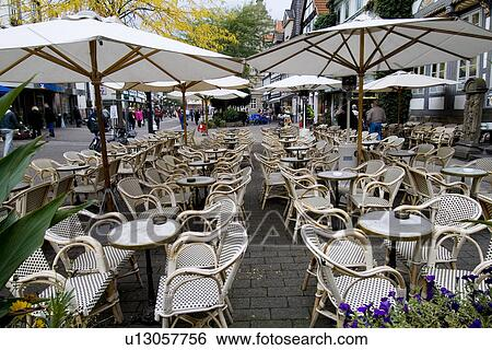 Stock Photograph Tables With Umbrellas And Chairs In An Outdoor Restaurant Fotosearch