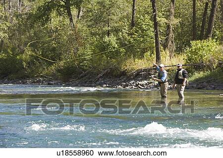 Fly-fishing guide, Russ Trand, fly-fishing with client on tributary of Elk  River near Fernie, Elk Valley, East Kootenays, British Columbia, Canada