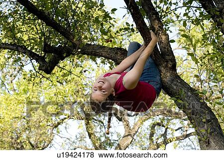 Girl Hanging Upside Down From a Tree Girl Hanging Upside Down