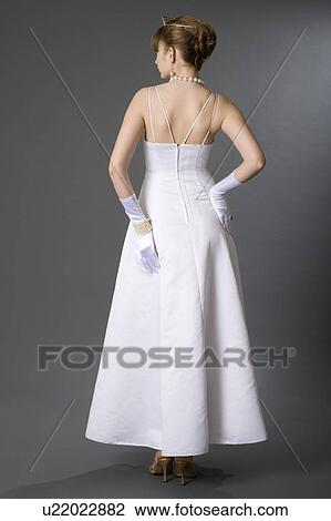 Stock Photo Of Teenage Girl In Formal Dress And Gloves Rear View