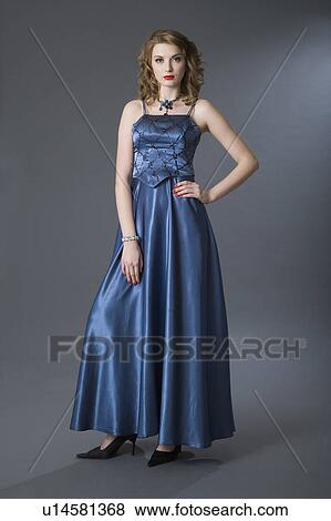 Pictures Of Teenage Girl In Formal Dress With Arms Akimbo U14581368