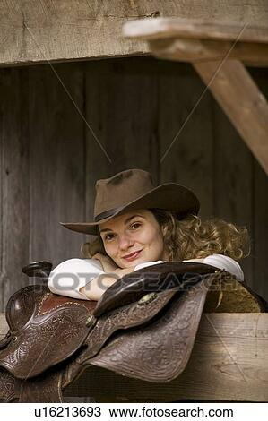 d8e9b39e3782d Stock Photo - thirty-one year old blond woman wearing a cowboy hat and horse