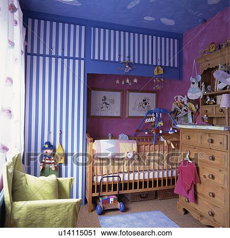 Blue White Striped Wallpaper On Fitted Cupboards In Pink