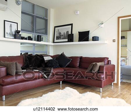 Brown leather corner sofa in modern living room Stock Image ...