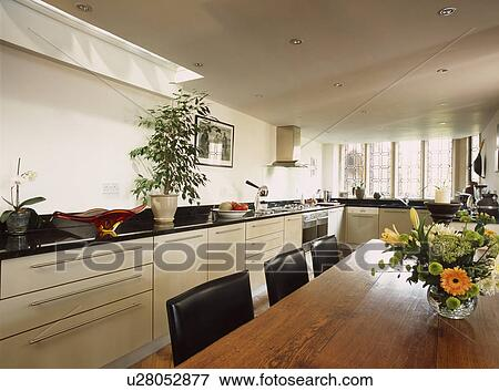 White Kitchen With Large Wooden