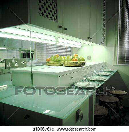 Stock Image of Contemporary white kitchen with blue gl counter ... on mirror tile backsplash ideas, beautiful classic kitchen white, mirror tile back splash for kitchen,