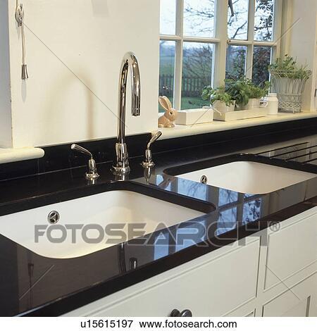 Black Granite Kitchen Sink.Double White Sinks And Chrome Taps In Black Granite Worktop