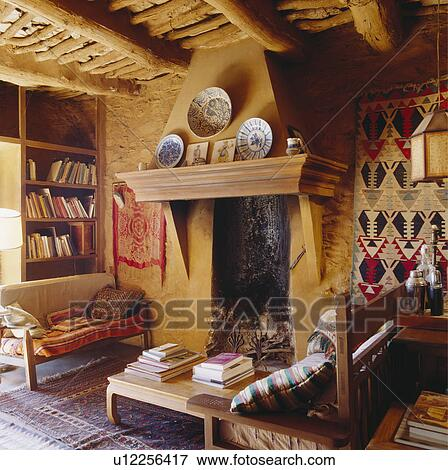 Fireplace In Rustic Spanish Country Living Room Stock Photo