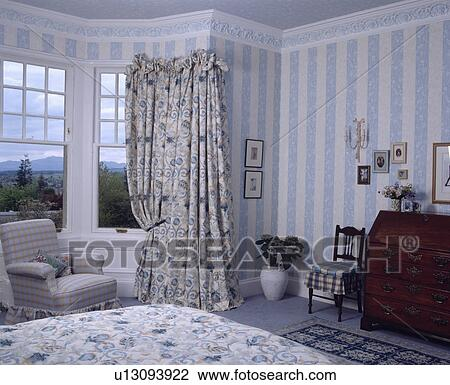 Stock Photo Of Floral Curtains At Bay Window In