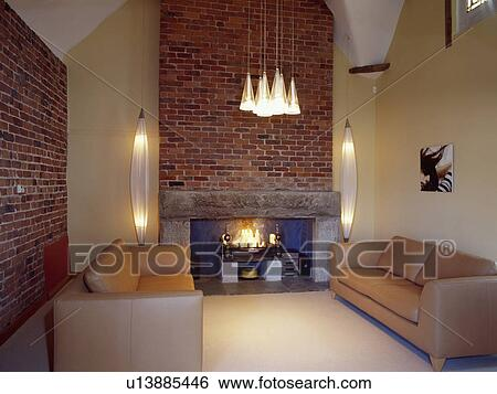 Leather sofas in modern country living room with fireplace ...