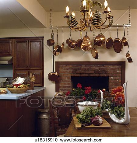 Stock Photography Of Metal Ferns On Lighted Chandelier Above Table