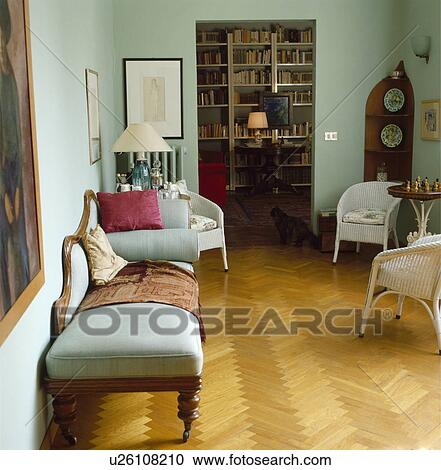 Parquet floor in traditional living room with Lloyd Loom ...
