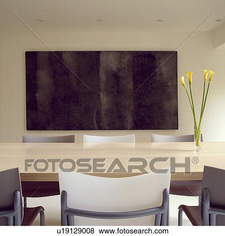 Philippe Starck U0027Cheap Chicu0027 Chairs And Boffi Monforte Maple Topped Table  In Architectural Diningroom With Large Black Painting On Wall