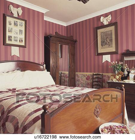 Pictures On Pink Striped Wallpaper In Bedroom With Pink