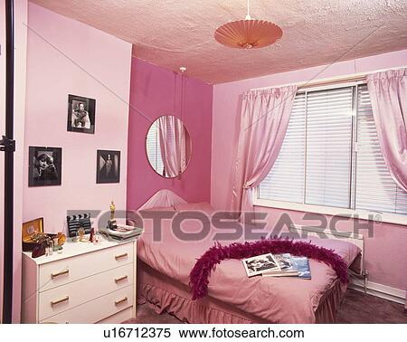Pink Curtains And Duvet In Economy Style Pink Bedroom With White Chest Of Drawers Stock Photography U16712375 Fotosearch