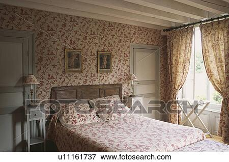 Picture   Red Toile De Jouy Wallpaper In Country Bedroom With Matching  Bedlinen And Curtains.