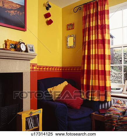 Red+yellow checked curtains in yellow+red living room Stock ...