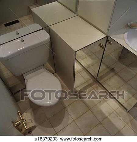 Toilet Beside Mirrored Storage Units In Modern Bathroom Stock Image U16379233 Fotosearch