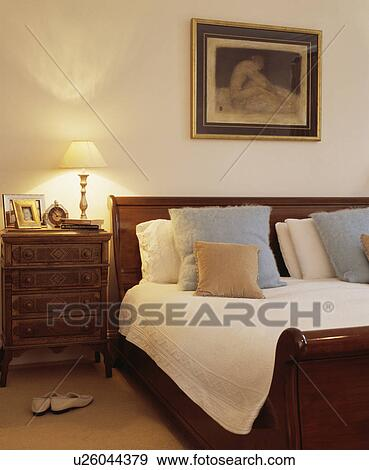Stock Photo Traditional Dark Wood Bed And Bedside Table In A Large White Bedroom