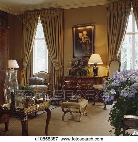 Traditional Neutral Living Room With Beige Curtains And Lighted