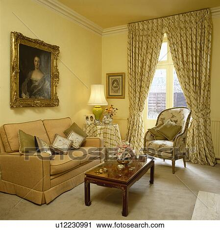 Traditional yellow living room with patterned curtains and ...