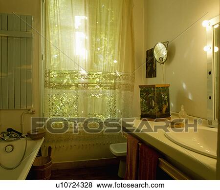 White Lace Curtains At Window Of