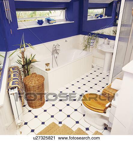 Wicker Laundry Basket Beside Bath Below
