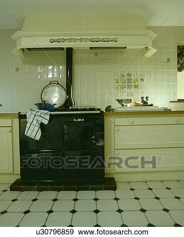 Black Aga In Cream Kitchen With White Ceramic Floor Tiles