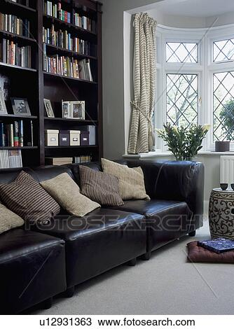 Black Leather Sofa With Cream Cushions