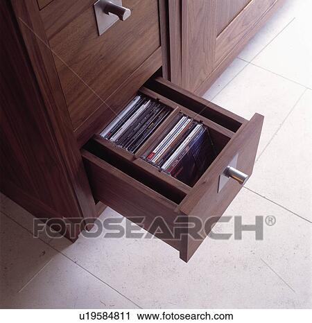 Close Up Of Open Drawer With CD Storage