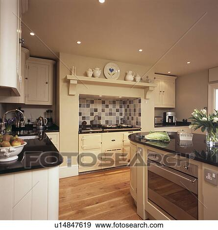 Stock Photograph Cream Aga Oven In Country Kitchen With Built Island