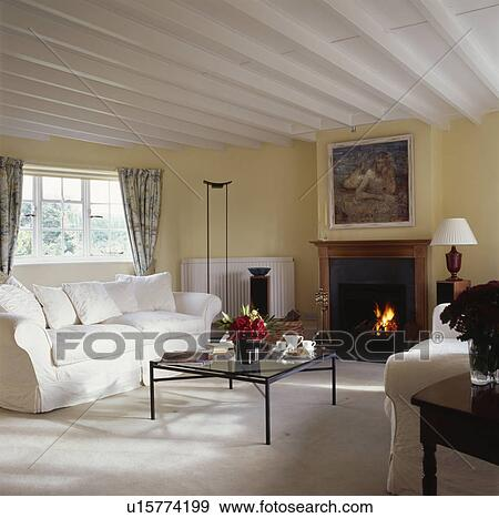 Cream Sofa In Traditional Living Room With Painted White Beamed Ceiling