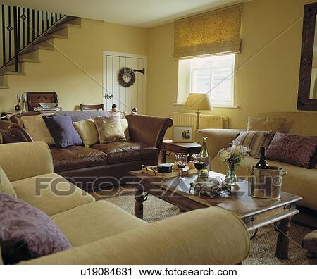 Cream Sofas And Yellow Blind In Pastel Cottage Living Room