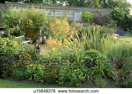Marigolds And Grasses In Border In Large Country Garden In Summer