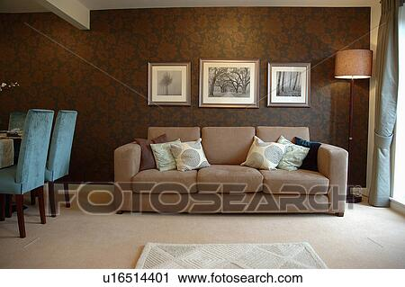 Modern apartment livingroom with patterned brown wallpaper and ...