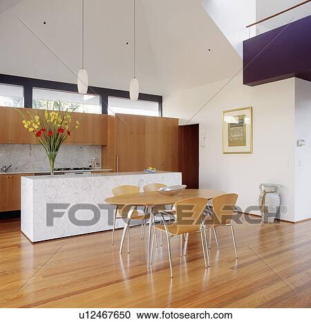 Superbe Pale Wood And Metal Chairs And Table In Modern White Kitchen With Wooden  Flooring And High Ceiling