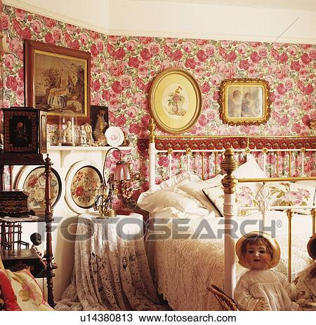 Pink rose-patterned wallpaper and antique brass and white ...