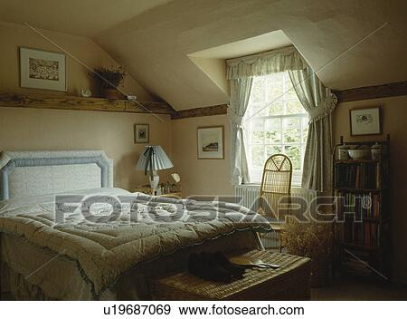 Attic Bedroom With Wicker Chair