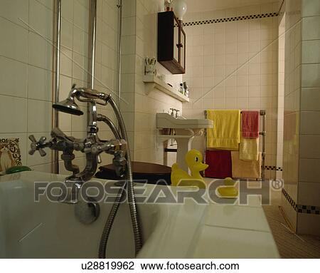 Stock Photo of Stainless steel taps and showerhead on bath with ...