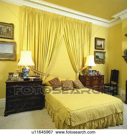 Curtains Ideas curtains matching wallpaper : Picture of Patterned yellow wallpaper and matching curtains behind ...