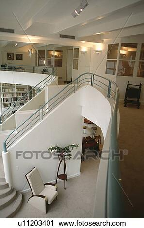 Aerial View Of Hall And Staircase In Openplan Modern White Loft Conversion  With Green Metal Bannister Rails