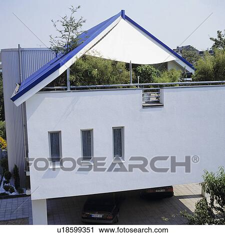 Blue Roof Above Terrace On Modern White House In The Country