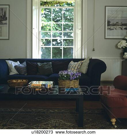 Outstanding Chesterfield Sofa In Front Of Tall Window Of Livingroom With Creativecarmelina Interior Chair Design Creativecarmelinacom