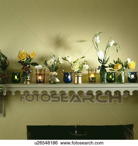 Stock Images Of Close Up Of Fresh Flowers In Vases And Lighted