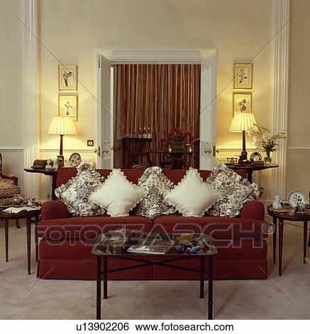Cream Cushions On Red Sofa In Traditional Living Room
