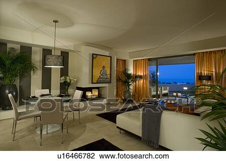 Large Openplan Living And Dining Room With View Of Balcony At Night