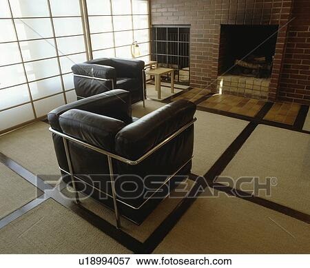 Le Corbusier Black Leather And Chrome Armchairs In Modern Living Room With Cream Carpet Inset With Wood Stock Photo U18994057 Fotosearch