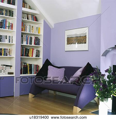 Modern dark purple sofa in mauve living room with wall of ...