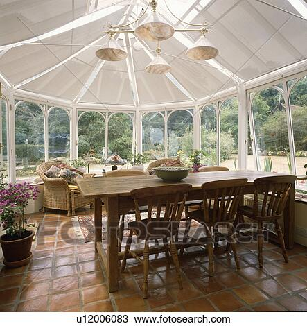 Old Rectangular Pine Table And Chairs In Conservatory Dining Room With Terracotta Tiled Floor Stock Image U12006083 Fotosearch